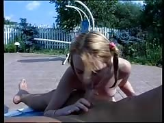 Blonde sucks cock by the pool