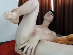 Lady pounds her asshole with big toy, spreads pussy.