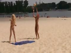 Hot teen nudists play at beach.