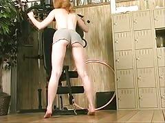 Lusty brunette babe has steamy gym fun