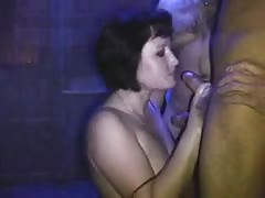 Short-haired Russian lady is sucking two dicks in the same time