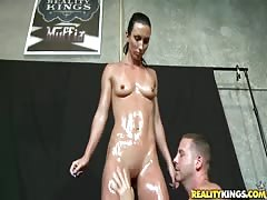 Sweet oiled slut is undressing and posing for a new photoshoot