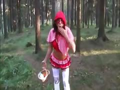 Sweet young babe is revealing her pussy in the forest