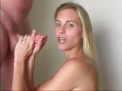 Smiling milf is wanking a dick and waiting for a cumshot