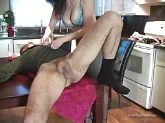 Brunette is kneeling down and starting to lick her hubby's butthole